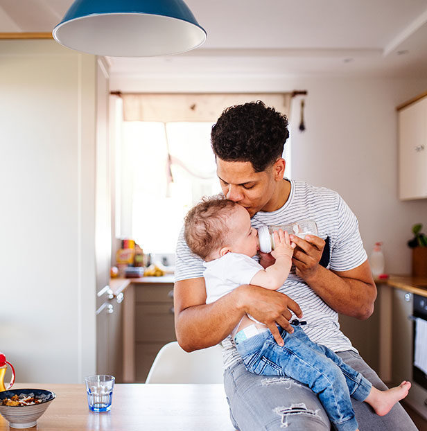 Man-feeding-baby-with-bottle
