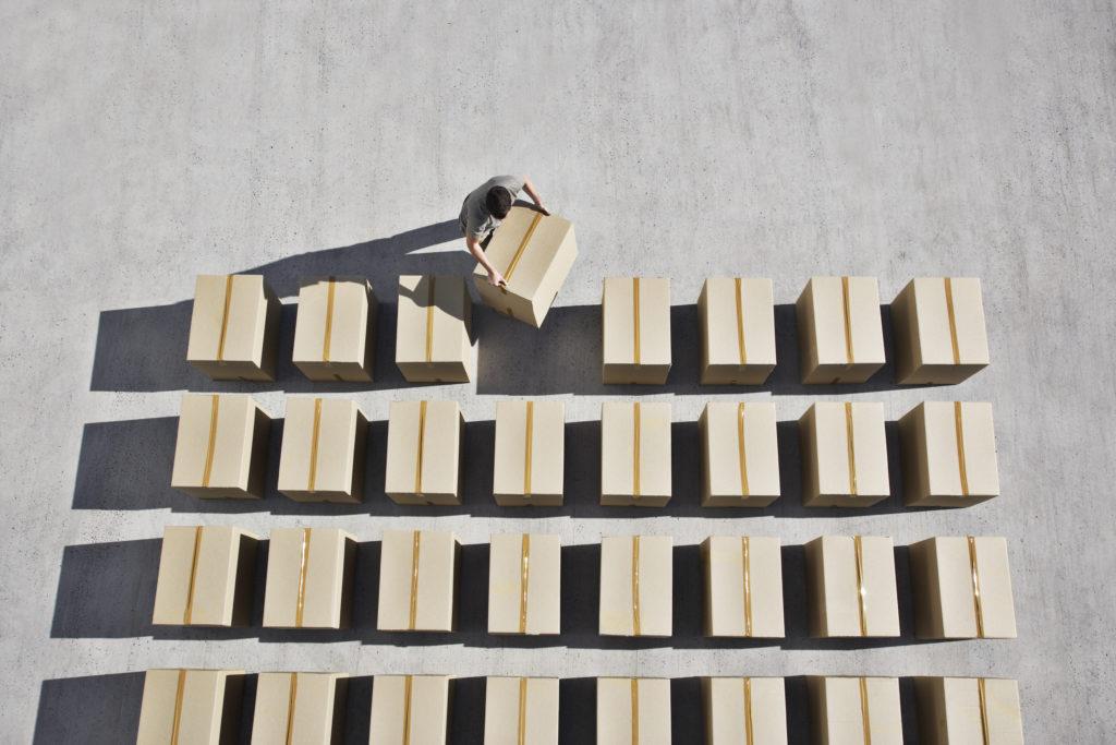 Man placing box into line