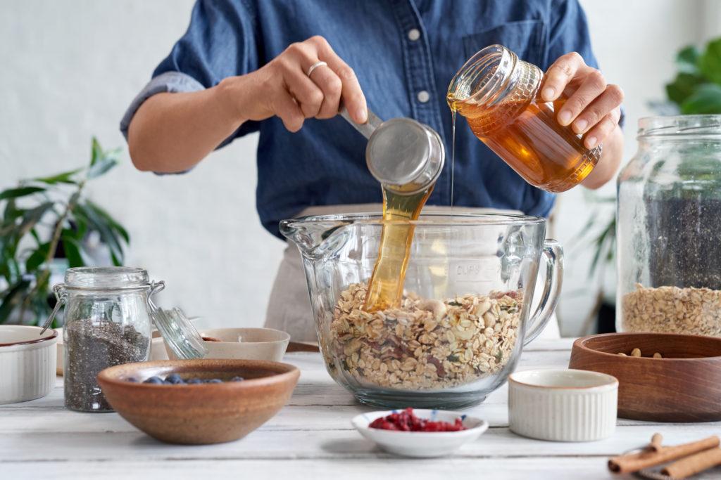 Woman At Home Making Homemade Granola